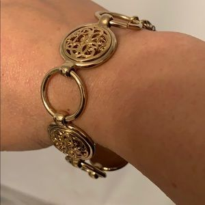 Monet women's circle gold tone toggle bracelet